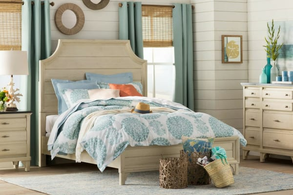 bedroom with shiplap walls, shiplap head board and aqua decor