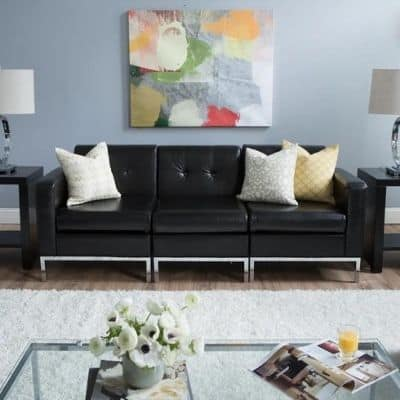 blue gray paint in living room with bright accent painting