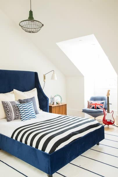 bedroom with white walls and navy bedding