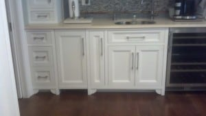 Which comes first the kitchen cabinets or the hardwoo for Flooring or cabinets first