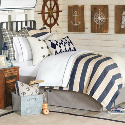 nautical bedroom with navy white decor and white shiplap