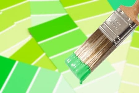 Paint testers - green paint samples and paint brushh