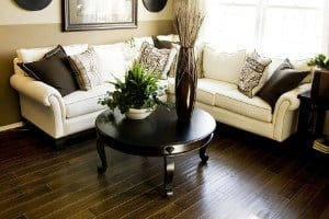 how to make your space look larger when you have dark hardwood floors