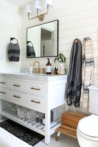 white farmhouse bathroom with white vanity