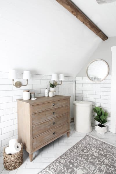 farmhouse style bathroom with low slanted ceiling.