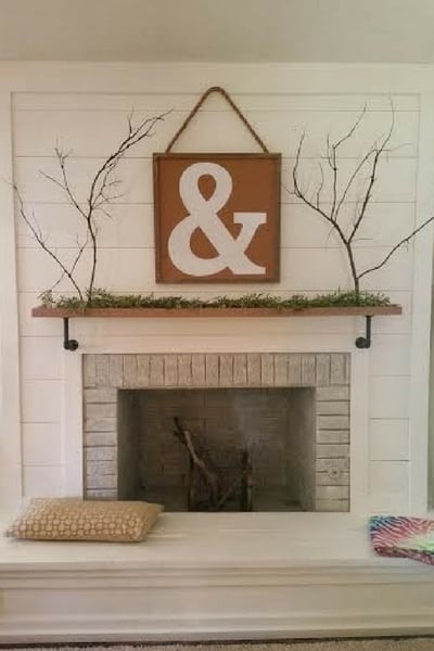 Shiplapped paneled fireplace for farmhouse style | decorate with shiplap