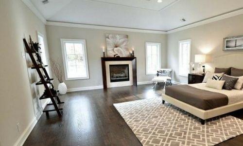 bedroom with dark hardwood flooriing for flipping homes