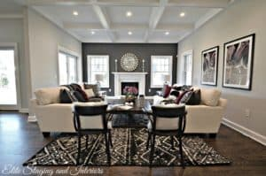 do dark hardwoods make your space larger - trick - use a dark accent wall