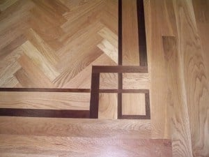 walnut border with oak hardwood - popular species for floors