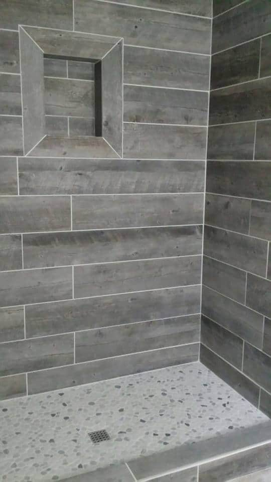 show with gray tiles that looks like hardwood