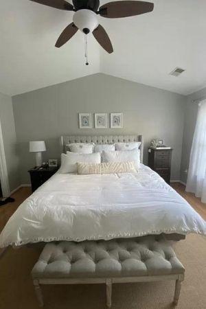 Sherwin Williams greige with green undertones in bedroom