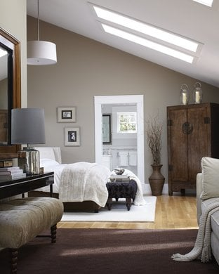 warm greige bedroom with skylights