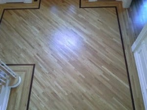 light hardwood floors with dark border and oil based poly